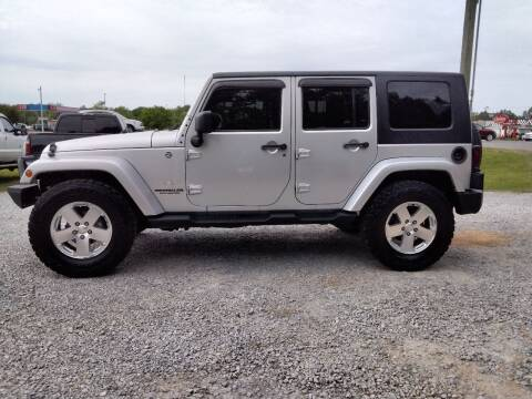 2009 Jeep Wrangler Unlimited for sale at NORTHWOOD TRUCK SALES in Northport AL