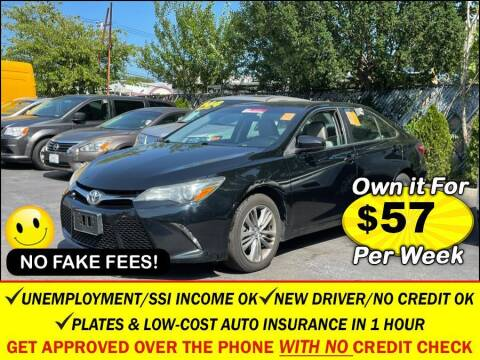 2015 Toyota Camry for sale at AUTOFYND in Elmont NY