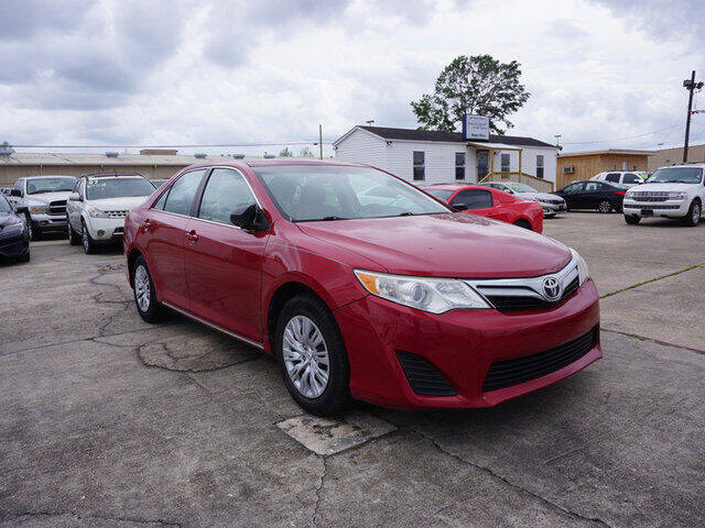 2014 Toyota Camry for sale at BLUE RIBBON MOTORS in Baton Rouge LA