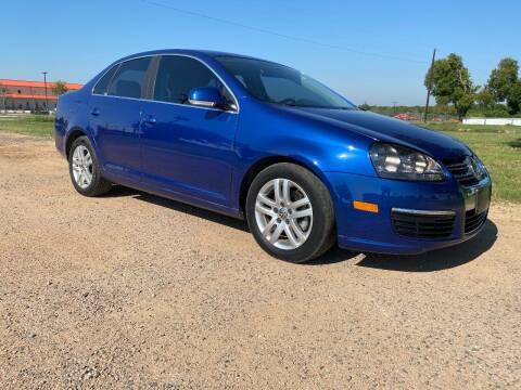 2009 Volkswagen Jetta for sale at CAVENDER MOTORS in Van Alstyne TX