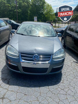 2009 Volkswagen Jetta for sale at LAKE CITY AUTO SALES in Forest Park GA