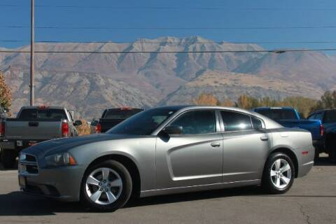 2011 Dodge Charger for sale at REVOLUTIONARY AUTO in Lindon UT