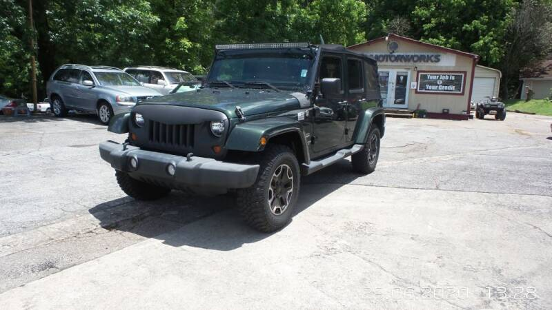 2011 Jeep Wrangler Unlimited for sale at E-Motorworks in Roswell GA
