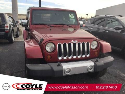 2011 Jeep Wrangler Unlimited for sale at COYLE GM - COYLE NISSAN - Coyle Nissan in Clarksville IN