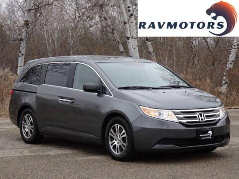 2012 Honda Odyssey for sale at RAVMOTORS in Burnsville MN