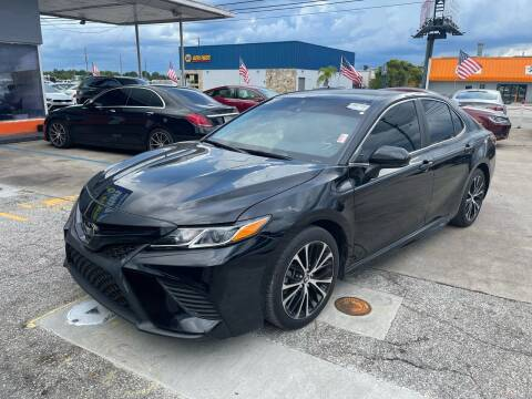 2018 Toyota Camry for sale at P J Auto Trading Inc in Orlando FL