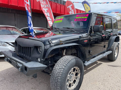 2016 Jeep Wrangler Unlimited for sale at Duke City Auto LLC in Gallup NM