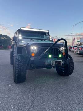 2012 Jeep Wrangler Unlimited for sale at Good Clean Cars in Melbourne FL