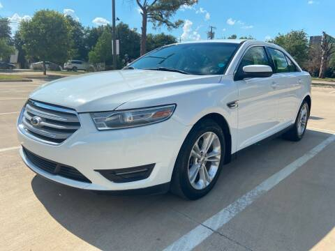 2014 Ford Taurus for sale at Safe Trip Auto Sales in Dallas TX