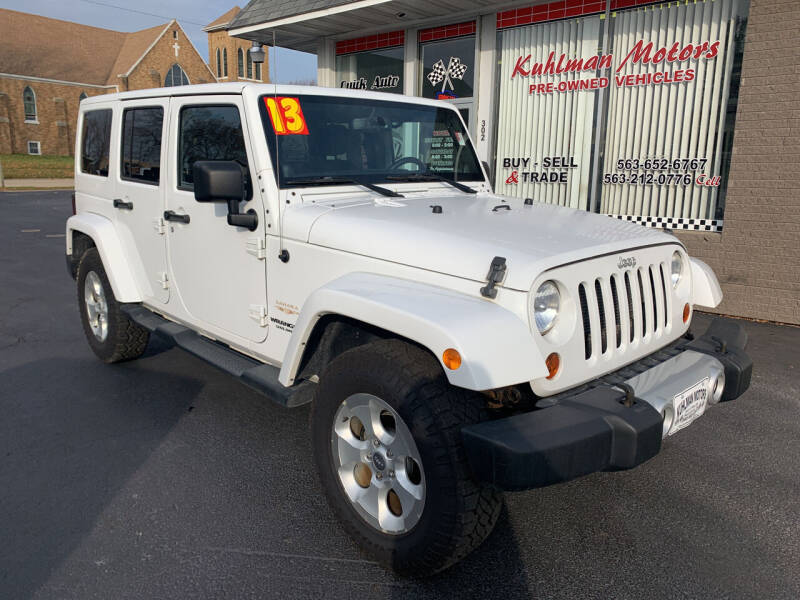 2013 Jeep Wrangler Unlimited for sale at KUHLMAN MOTORS in Maquoketa IA