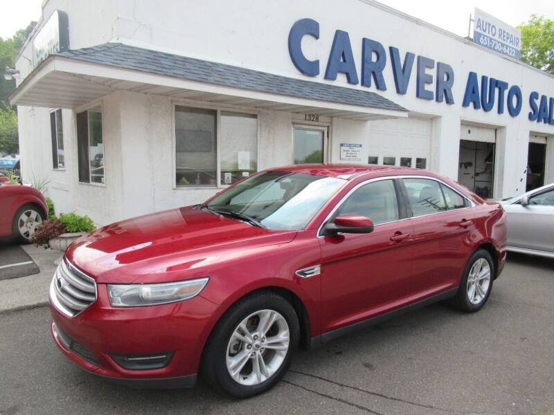 2014 Ford Taurus for sale at Carver Auto Sales in Saint Paul MN