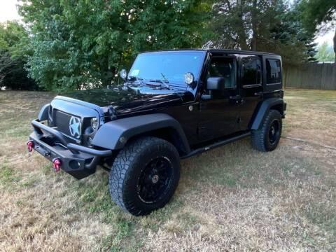 2013 Jeep Wrangler Unlimited for sale at Boston Auto Cars in Dedham MA