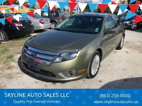 2012 Ford Fusion Hybrid for sale at SKYLINE AUTO SALES LLC in Winter Haven FL