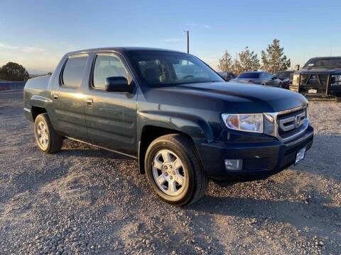 2011 Honda Ridgeline for sale at BERKENKOTTER MOTORS in Brighton CO