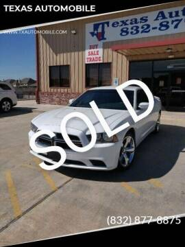 2014 Dodge Charger for sale at TEXAS AUTOMOBILE in Houston TX