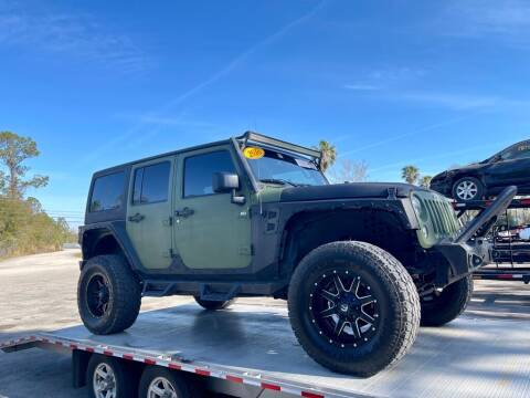 2016 Jeep Wrangler Unlimited for sale at Blum's Auto Mart in Port Orange FL
