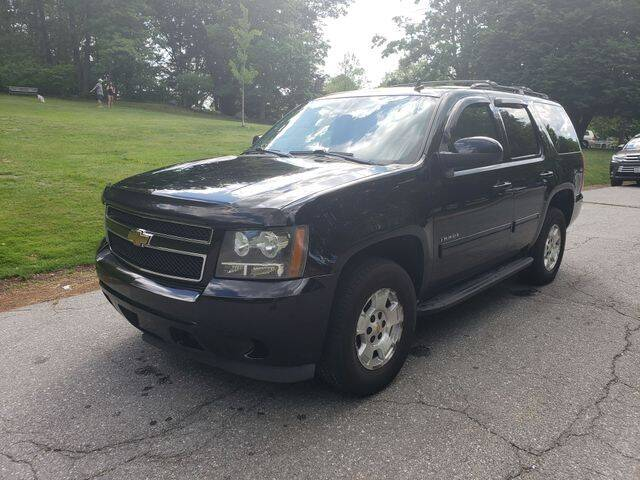 2011 Chevrolet Tahoe for sale at NEW ENGLAND AUTO CENTER in Lowell MA