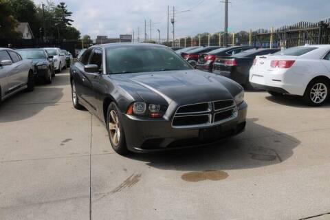 2014 Dodge Charger for sale at F & M AUTO SALES in Detroit MI