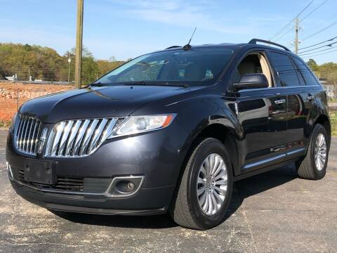2013 Lincoln MKX for sale at Capital Motors in Raleigh NC