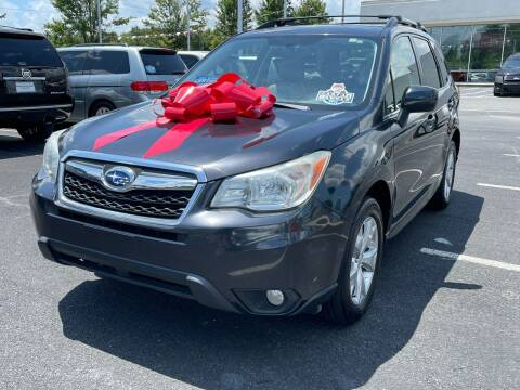 2014 Subaru Forester for sale at Charlotte Auto Group, Inc in Monroe NC