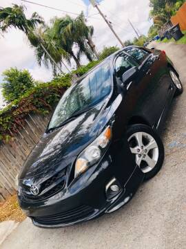 2012 Toyota Corolla for sale at IRON CARS in Hollywood FL