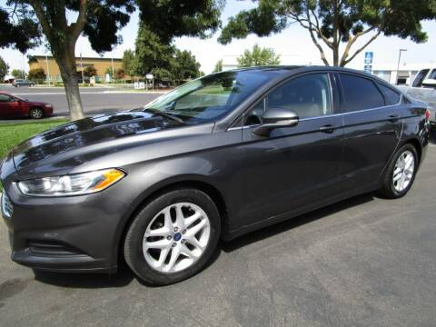 2016 Ford Fusion for sale at KM MOTOR CARS in Modesto CA