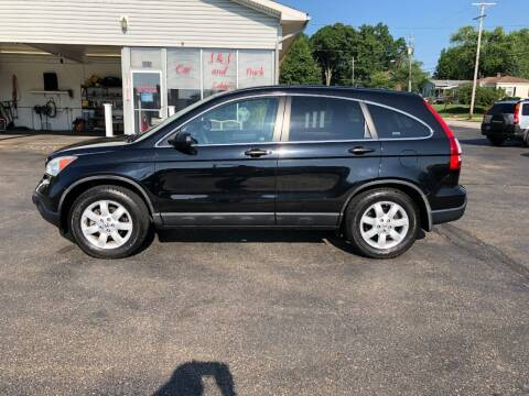 2009 Honda CR-V for sale at J&J Car and Truck Sales in North Canton OH