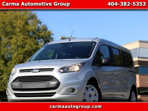 2015 Ford Transit Connect Wagon for sale at Carma Auto Group in Duluth GA