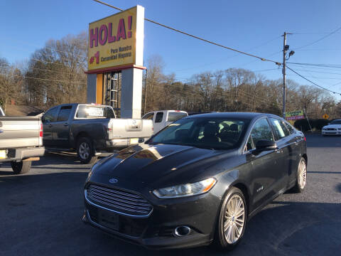2013 Ford Fusion Hybrid for sale at No Full Coverage Auto Sales in Austell GA