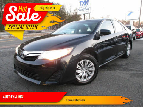 2014 Toyota Camry for sale at AUTOTYM INC in Fredericksburg VA