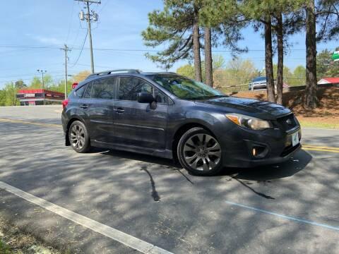 2012 Subaru Impreza for sale at THE AUTO FINDERS in Durham NC