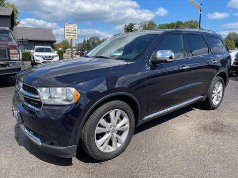 2011 Dodge Durango for sale at HUFF AUTO GROUP in Jackson MI