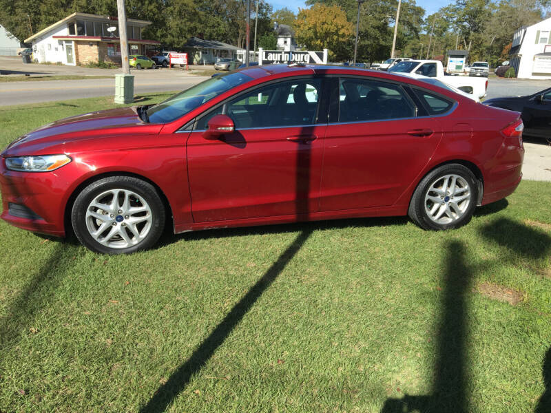 2016 Ford Fusion for sale at LAURINBURG AUTO SALES in Laurinburg NC
