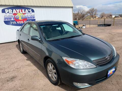 2004 Toyota Camry for sale at Praylea's Auto Sales in Peyton CO