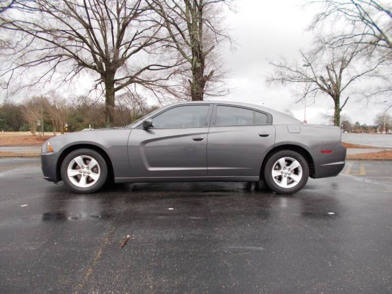 2013 Dodge Charger for sale at A & P Automotive in Montgomery AL