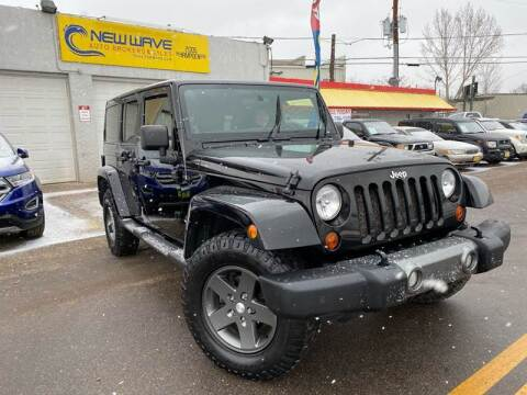 2011 Jeep Wrangler Unlimited for sale at New Wave Auto Brokers & Sales in Denver CO