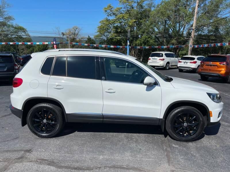 2017 Volkswagen Tiguan for sale at MAGNUM MOTORS in Reedsville PA