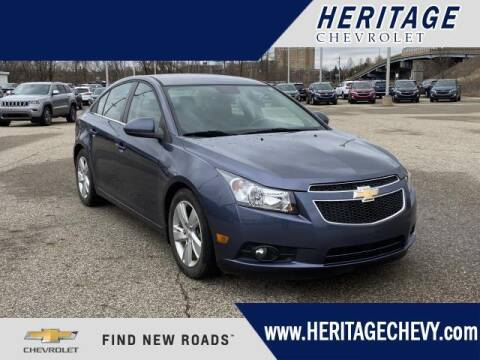 2014 Chevrolet Cruze for sale at HERITAGE CHEVROLET INC in Creek MI