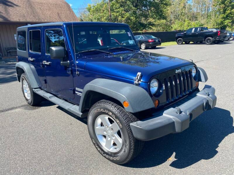 2013 Jeep Wrangler Unlimited for sale at Suburban Wrench in Pennington NJ