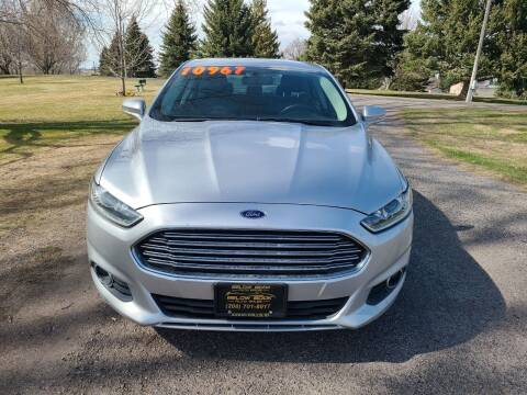2016 Ford Fusion for sale at BELOW BOOK AUTO SALES in Idaho Falls ID