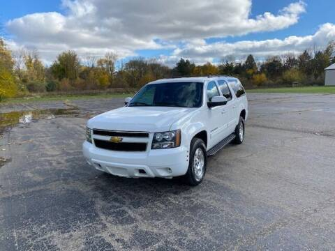 2013 Chevrolet Suburban for sale at Caruzin Motors in Flint MI