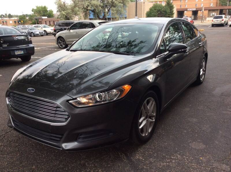 2015 Ford Fusion for sale at AROUND THE WORLD AUTO SALES in Denver CO