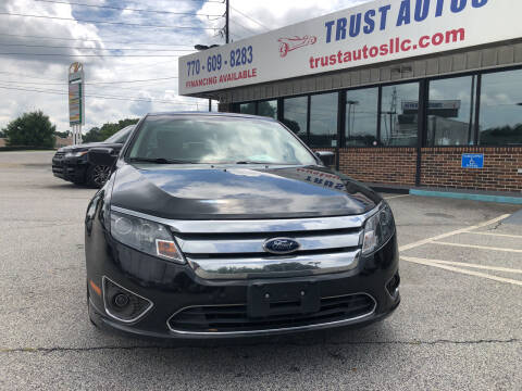 2011 Ford Fusion Hybrid for sale at Trust Autos, LLC in Decatur GA