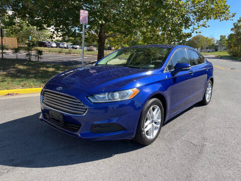 2014 Ford Fusion for sale at Dreams Auto Group LLC in Sterling VA