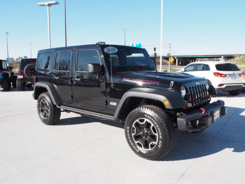 2013 Jeep Wrangler Unlimited for sale at SIMOTES MOTORS in Minooka IL