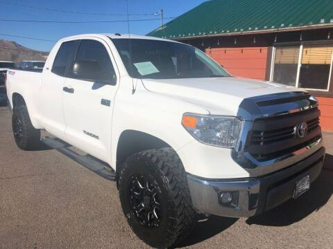 2015 Toyota Tundra for sale at BERKENKOTTER MOTORS in Brighton CO