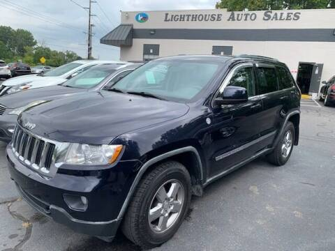 2011 Jeep Grand Cherokee for sale at Lighthouse Auto Sales in Holland MI