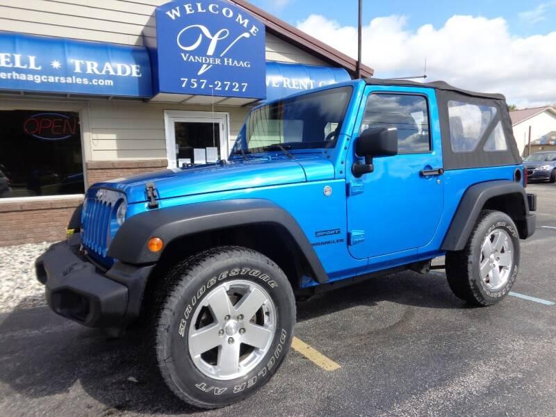 2015 Jeep Wrangler for sale at VanderHaag Car Sales LLC in Scottville MI