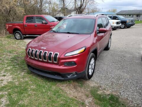 2016 Jeep Cherokee for sale at Clare Auto Sales, Inc. in Clare MI