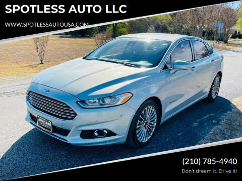 2014 Ford Fusion Hybrid for sale at SPOTLESS AUTO LLC in San Antonio TX
